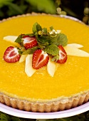 Mango tart with fresh strawberries