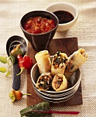 Spring rolls filled with chard, tomato and pepper sauce