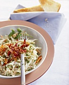 White cabbage salad with fried bacon and mayonnaise