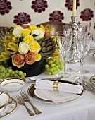Table laid for special occasion with flowers and menu