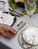 Table laid for special occasion with fish cutlery
