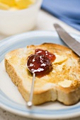 Buttered toast with strawberry jam