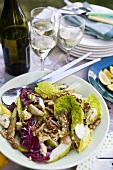 Salad leaves with pears, blue cheese and walnuts