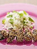 Chicken kebab with sesame seeds and minted rice