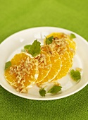 Orange slices with walnuts and mint
