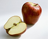 Whole apple and half an apple (variety: Red Chief)
