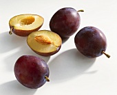Whole and halved plums (variety: Lepotica)