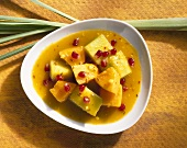 Melon curry with pomegranate seeds