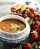 Tomato soup with tortilla chips in a soup tureen