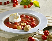 Cold sour cherry soup with whipped cream and amarettini