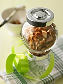 Almond brittle in a jar to give as a gift
