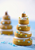 Christmas trees (stacked biscuits with icing & sugar pearls)