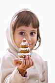 Girl with biscuit Christmas tree