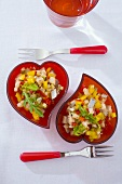 Herring salad in red heart-shaped dishes