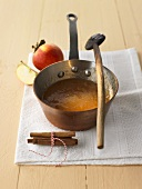 Apple and cinnamon jam in a copper pan