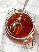 Quince jelly in jar with spoon
