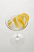 A glass of Martini with lemon peel