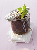 Plum compote with rum in a preserving jar