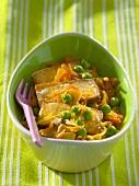 Fried tofu slices on vegetables