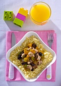 Pork with plums and apricots on couscous