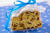 Christmas stollen with blue ribbon