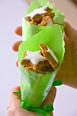 Star-shaped walut biscuits in green paper cones