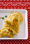 Cornmeal pasta envelopes with vegetable filling