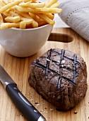 Grilled fillet steak with chips