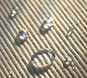Drops of water on table mat (close-up)