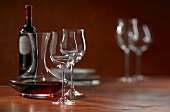 Red wine in decanter, glasses and a bottle