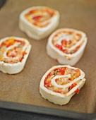 Pizza pinwheels on a baking tray