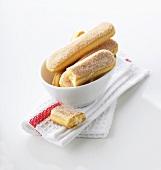 Sponge fingers in bowl on tea towel