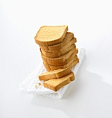 Zwieback, stacked, on tea towel