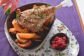 Turkey leg with pumpkin and cranberries