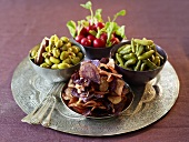 Vegetable crisps, olives, gherkins, radishes