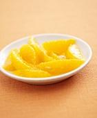 Orange segments in dish