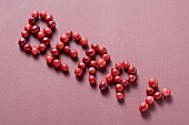 The word BERRY written in cranberries
