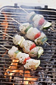 Fish and vegetable kebabs on a barbecue