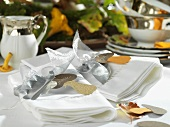 Table laid in white with autumnal decorations
