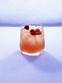 Pomegranate drink with raspberries and ice cubes
