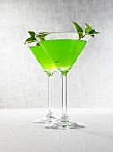 Two Melon Martinis with mint leaves