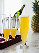 Three pineapple and sparkling wine cocktails