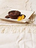Warm chocolate ricotta pudding with mandarin orange segments