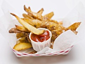 Chips in paper dish with ketchup