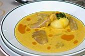 Potato soup with pork skin