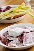 Floured beefsteaks and vegetables