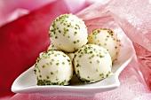 Pistachio truffles in a dish