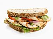 Chicken breast, onion & tomato sandwich (wholemeal bread)