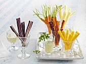 Different coloured carrot sticks and carrots with dip
