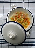 Vegetable soup with peas and leeks in a soup tureen